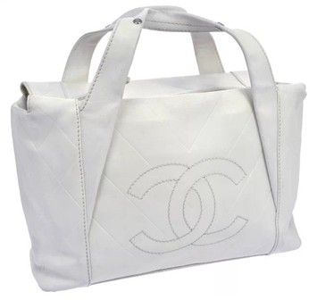 Chanel 100% Quilted Cc Logos Hand White Leather Vintage Italy Black Tote Bag. Get one of the hottest styles of the season! The Chanel 100% Quilted Cc Logos Hand White Leather Vintage Italy Black Tote Bag is a top 10 member favorite on Tradesy. Save on yours before they're sold out!