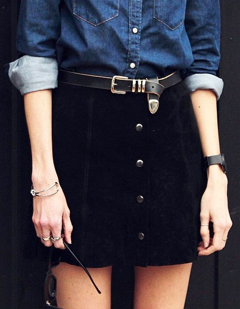 suede black mini skirt styled with a chambray shirt tucked