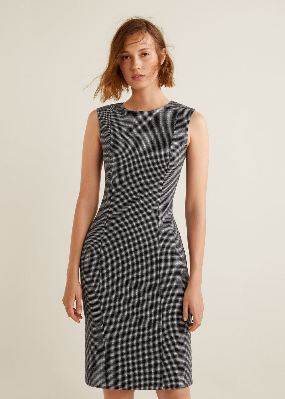 19fa0381f4 Fitted design Check print Sleeveless Round neck Tuck detail Back vent  Concealed back zip closure