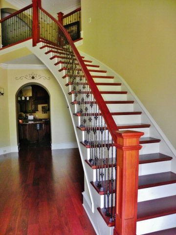 Best A Staircase With Decorative Metal Spindles Create A 400 x 300