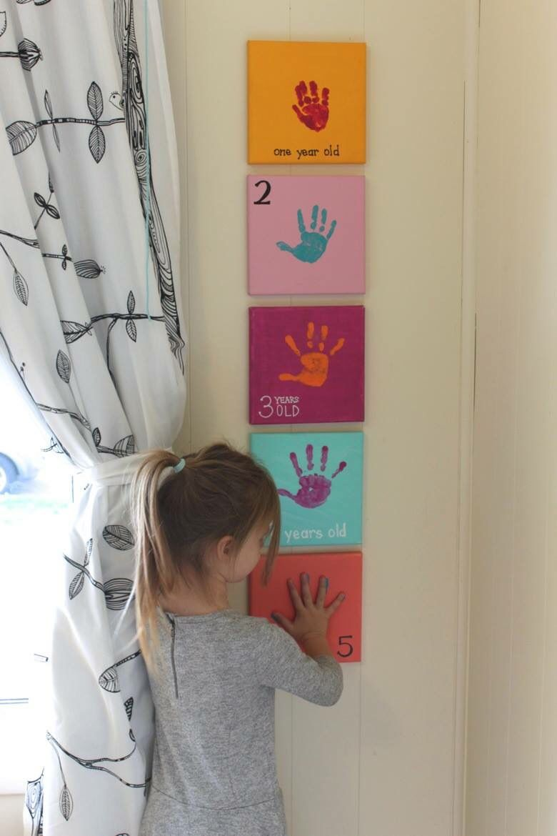 A handprint on a canvas for every age. Such a cute idea for a bedroom decoration!