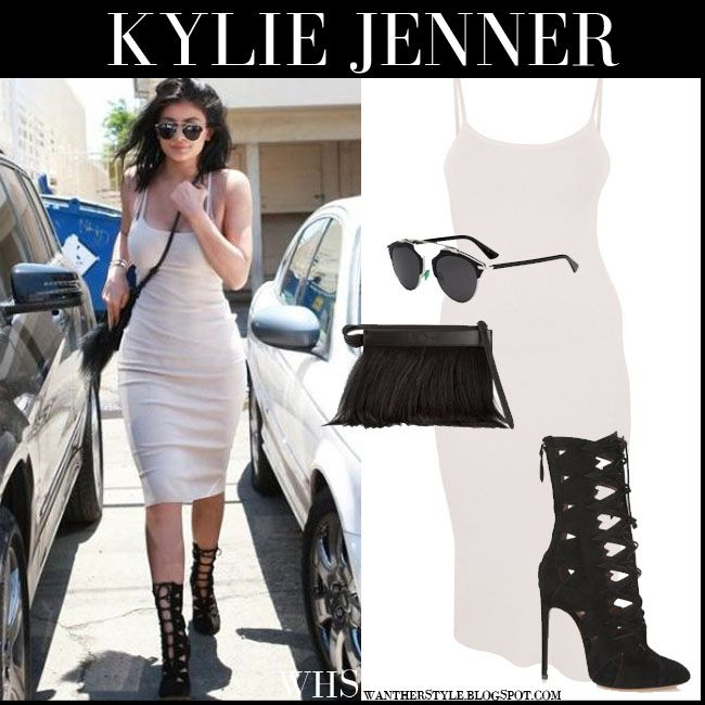 Kylie Jenner in grey suede boots and gold sleeveless dress ...