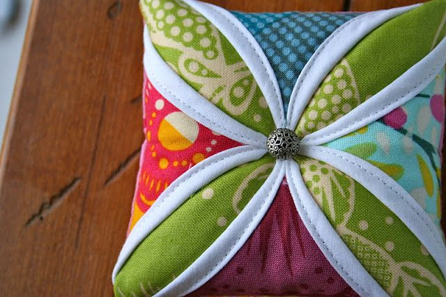 A beautiful little piece of fabric art, and a way to try your hand at cathedral windows.