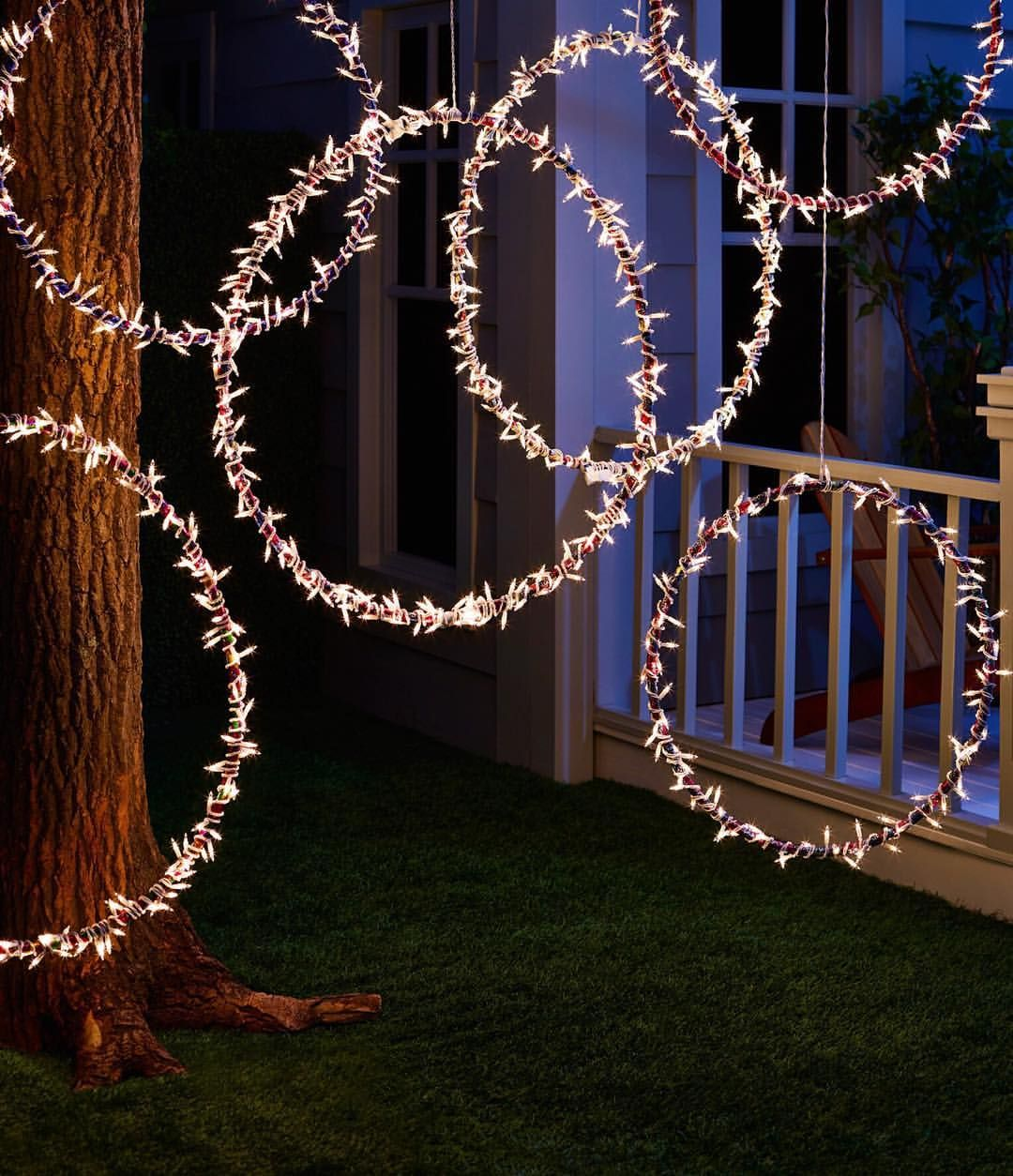 Instant backyard ambiance: just add hula hoops!  DIY Recreate this magical scene in your own yard by wrapping string lights around a few hula hoops and hanging them in a tree—and don't forget the extension cord! Shop the goods through the link in our profile.