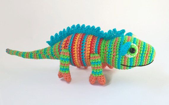 Crocheted Chameleon Would you like your child to have an unusual toy? Pay attention at this sweet and cute chameleon. Not very particular about food and unpretentious in everyday life, this crocheted chameleon will make a good friend for your child. You can have the tail coiled and fixed (at request). Length: 28 cm (11'') Yarn: YarnArt JEANS Stuffing material: Holofiber (hypoallergenic) Standard international shipping takes up to 20 business days.  Normal delivery time out from Ukraine takes…