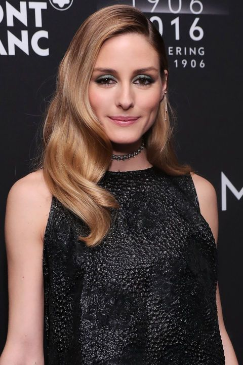 Who: Olivia Palermo What: Silky Waves  How-To: Palermo's trademark is great hair that has just the right amount of flyaways and bedhead texture to make it look effortless, but last night she took an unapologetically glamorous approach with soft and shiny S-waves. Get the look with a large-barrel curling iron (for tighter, more precise ripples, try a marcel iron) and a glossing serum.    Editor's Pick: Ciaté x Olivia Palermo Smokey Suedes Eye Palette, $39, bloomingdales.com.