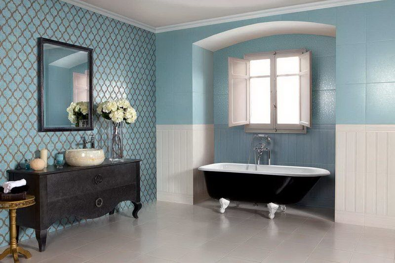 White bathroom floor tiles with blue wall colors and black vanity