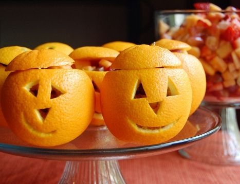Oranges carved with pumpkin faces that can hold jello, candy, really cold ice cream, anything you want