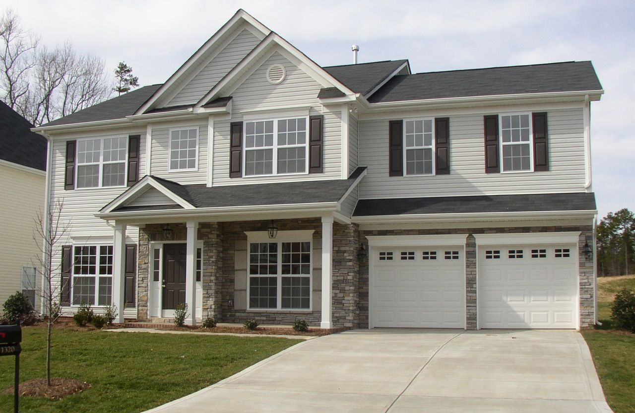 Color Scheme. Light Gray Siding. White Garage Doors And Trim. Gray Stone  With Some Beige In It, Dark Gray Roof And Door. Http://color4charlotte.fu2026