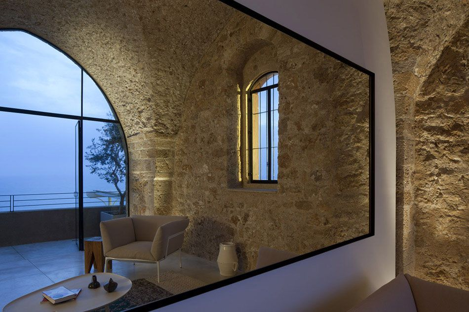 Old meets new in this amazing apartment rehab in tel aviv israel the jaffa apartment by pitsou kedem architect is a design than maintains the architectu