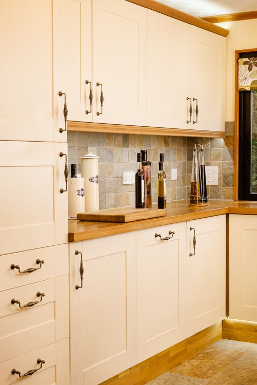 Full height solid oak cabinets with frontals painted in Farrows
