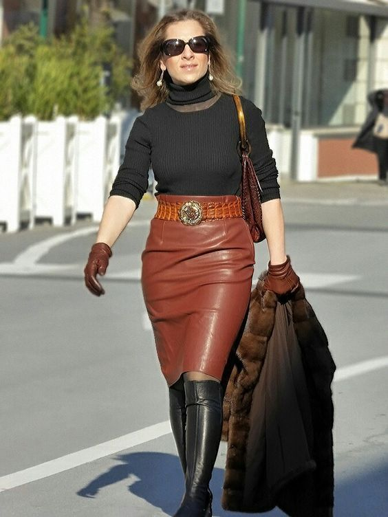 6765fcdab Brown faux leather pencil skirt worn with black turtleneck sweater, black  boots and brown gloves