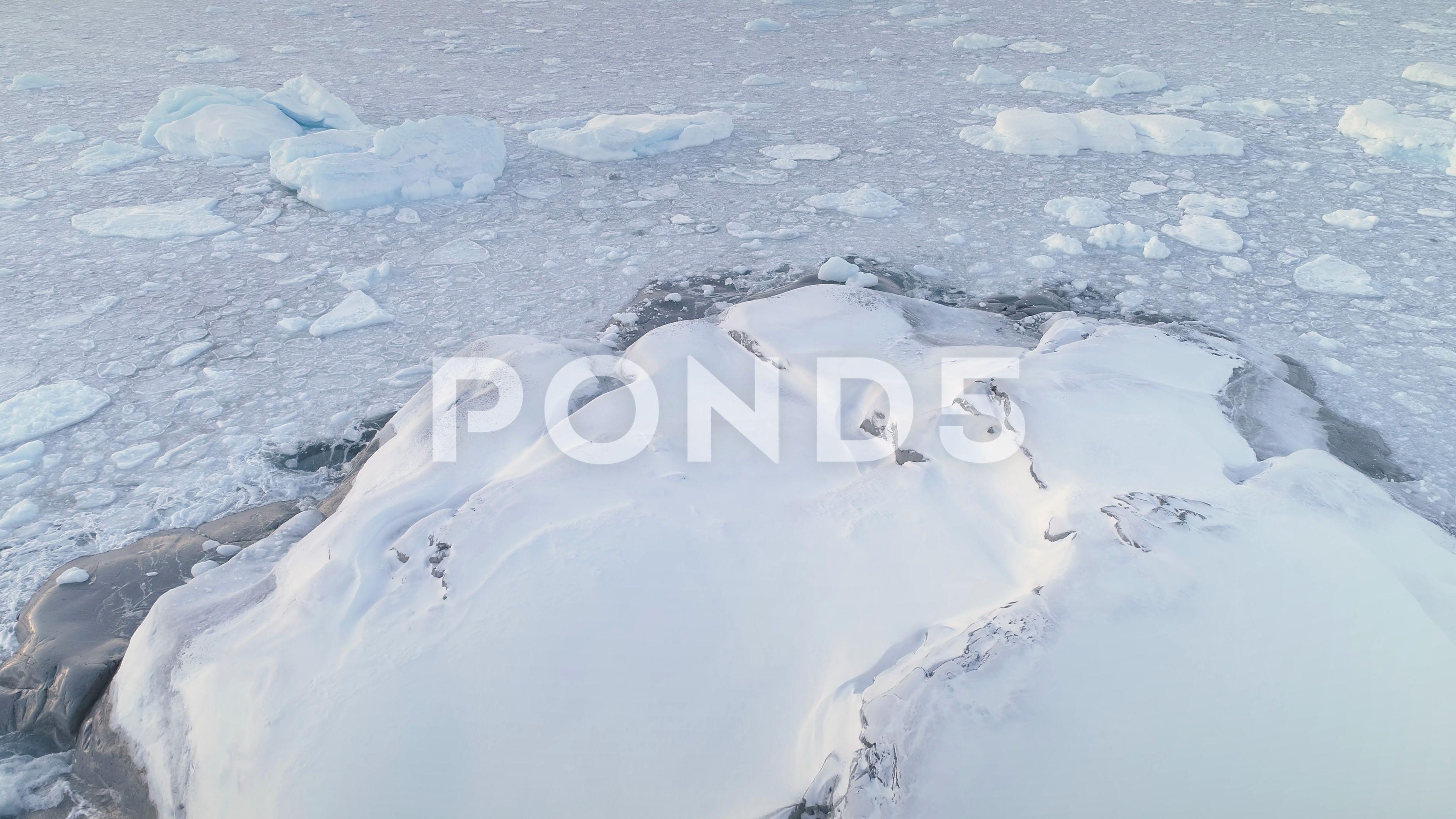 Snow covered land ice ocean antarctica shot stock