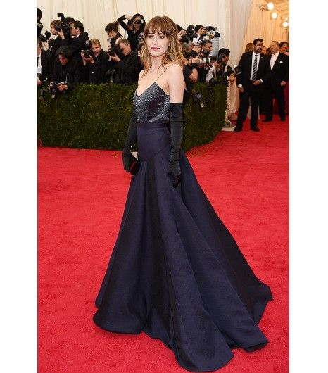 @Who What Wear - Dakota Johnson                 Jason Wu custom navy micro-beaded camisole with navy silk gauze full skirt; Lee Savage clutch, Christian Louboutin sandals; Carolina Amato black satin gloves with pearl buttons; Jennifer Meyer 18K yellow gold channel set studs.