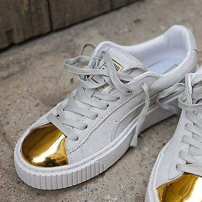 white pumas with gold toe
