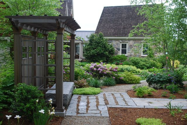 new england arbors landscape traditional with bluestone covered bench flowers garden granite bench gravel path iris metal roof