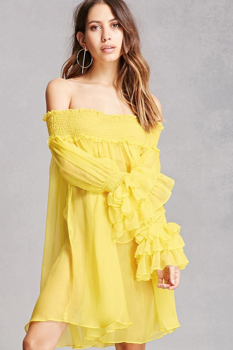 A sheer woven top featuring an off-the-shoulder neckline, smocked ...