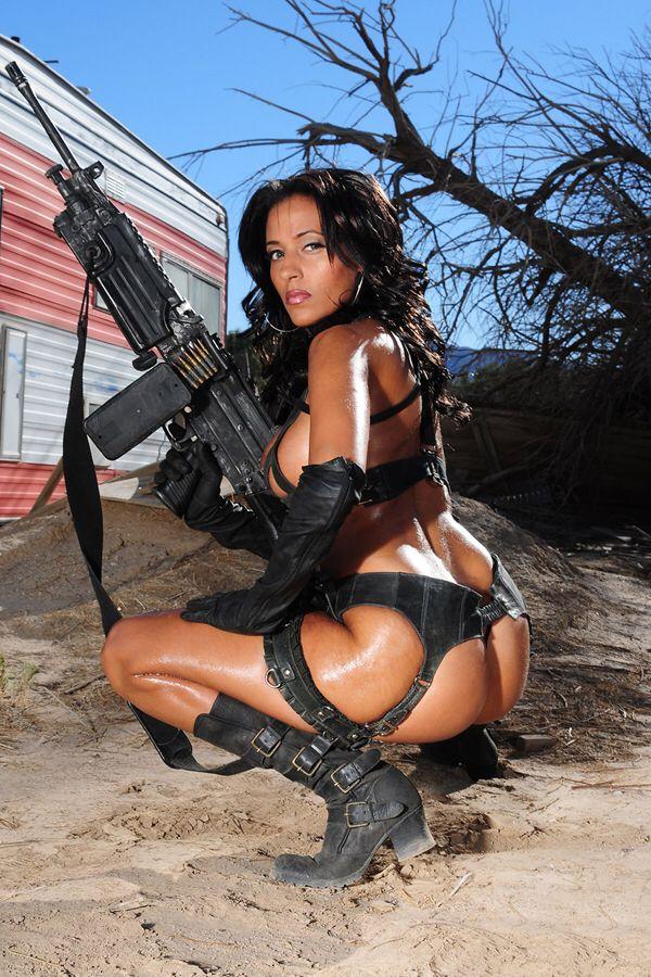 Nude women with machine guns