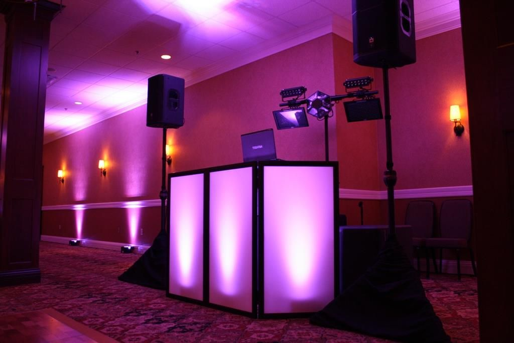 DJ setup with facade and purple uplighting provided by All-Star ...