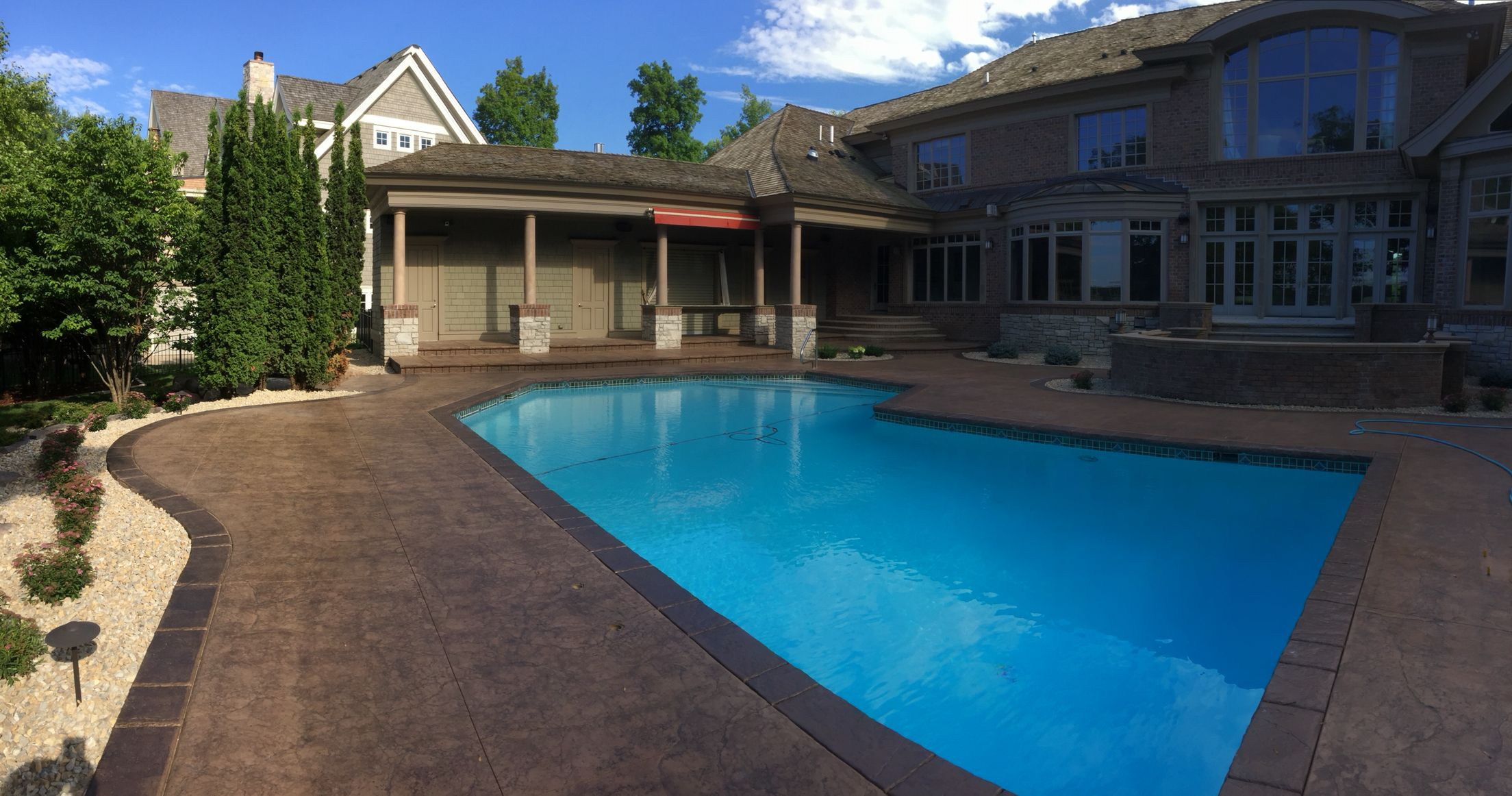 Stamped And Colored Concrete Pool Deck With Custom Chiseled Stone