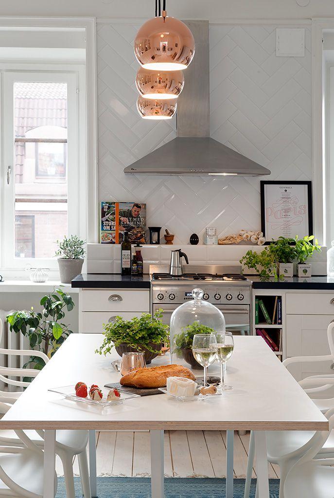 white herringbone tile backsplash + spice shelf + cookbook nook + copper pendants