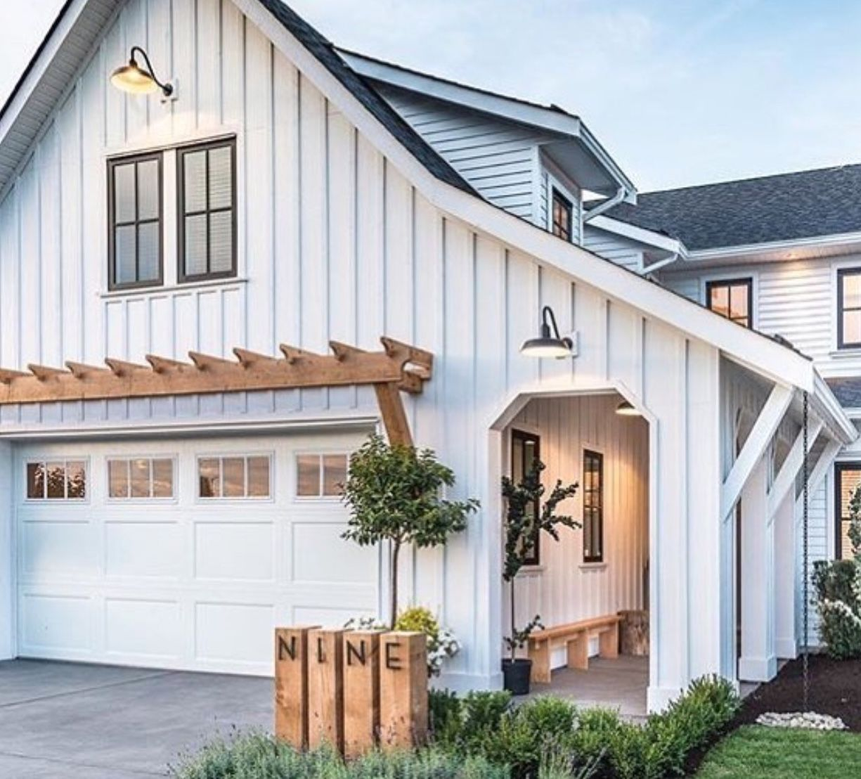 Love the wood over garage door | Modern farmhouse exterior ...