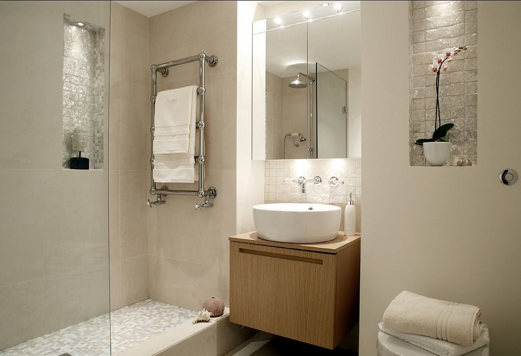 White bathroom with light-colored wood panels and large tub. Home by ...
