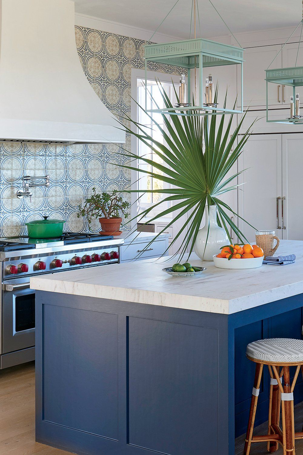 A classic white kitchen with white marble countertops is classic ...