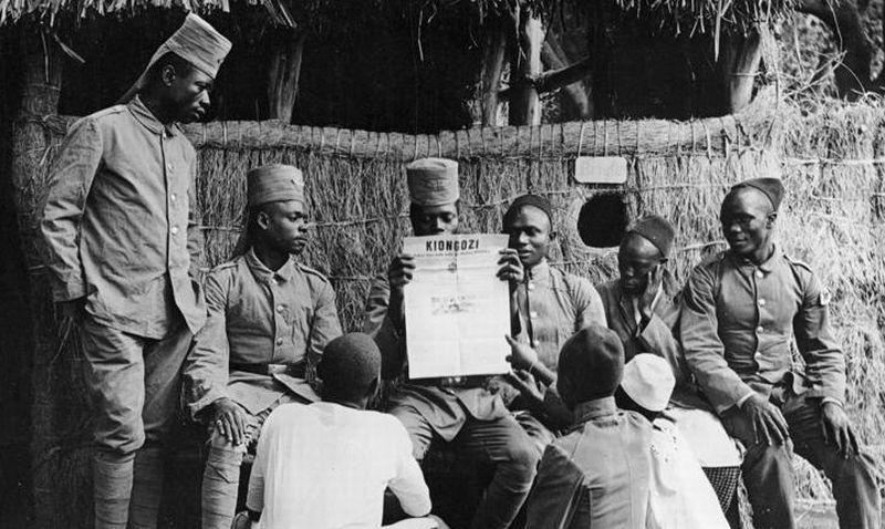 German Askaris Being Read a Newspaper