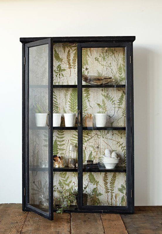 This Charming Black Wood Cabinet Holds Three Sturdy Shelves Behind