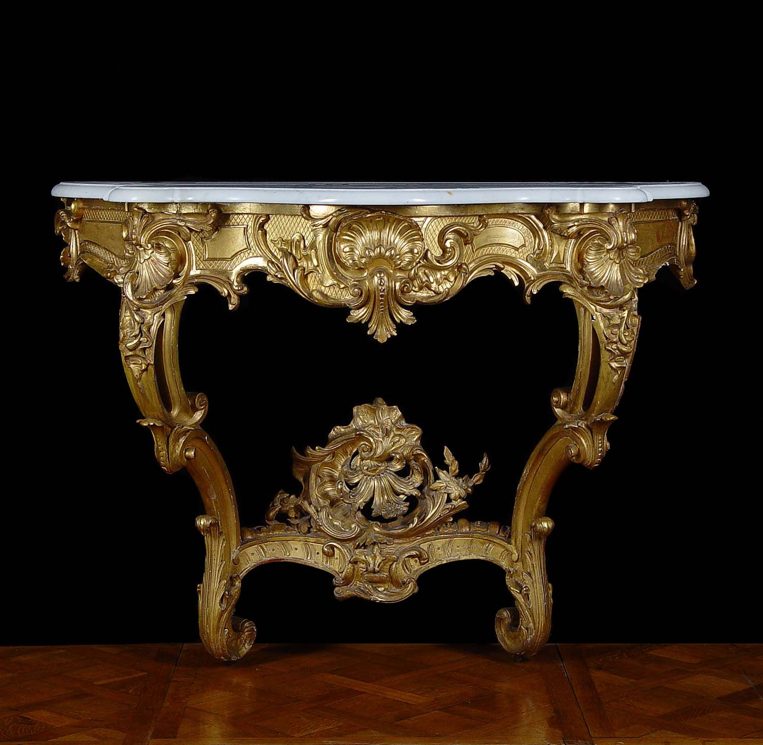 A Giltwood And Gesso Antique Console Table In The Louis Xv French Rococo Manner With High Relief S Rocaille Decoration On Serpentine Frieze