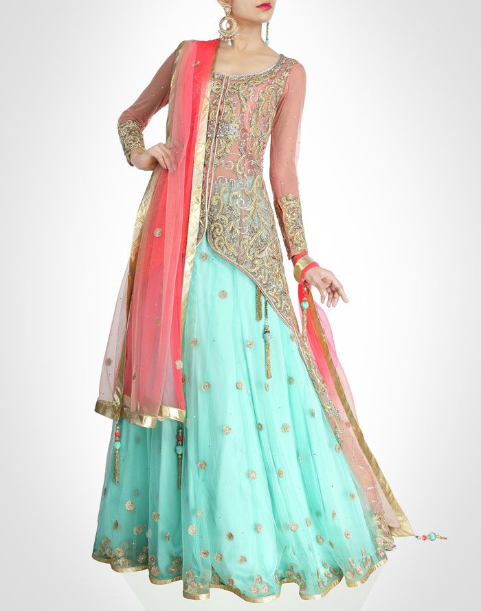 Define the feminine charm within you with this beautiful lehenga adorned with zardosi work all over in elegant sea green & orange shades. Team this regal attire with gold accent & statement clutch for added glamour.