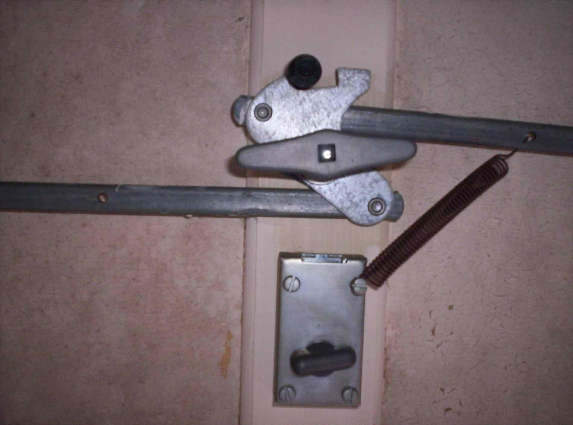 Pin By Home Design Geek On Door Latch Types Garage Door Lock Doors Garage Doors