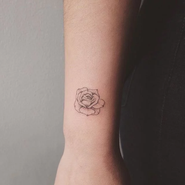 These Tiny Rose Tattoo Ideas Are All the Inspiration You'll Need For Your Next Ink