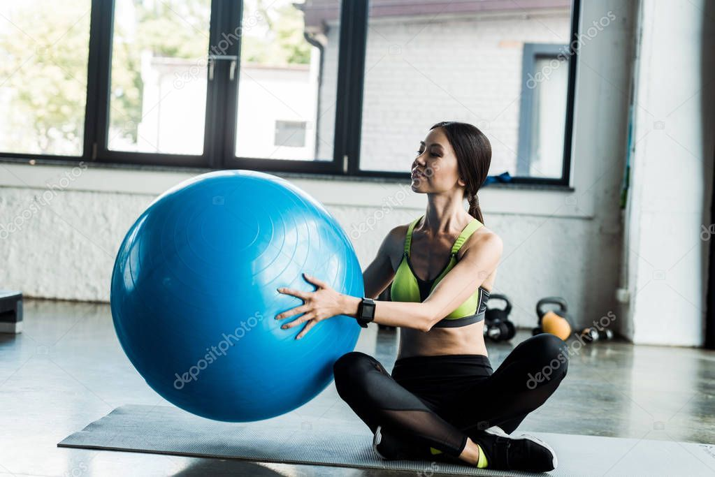 Happy Girl Holding Blue Fitness Ball While Sitting Fitness Mat - Stock Ph , #ad, #Blue, #Fitness, #H...