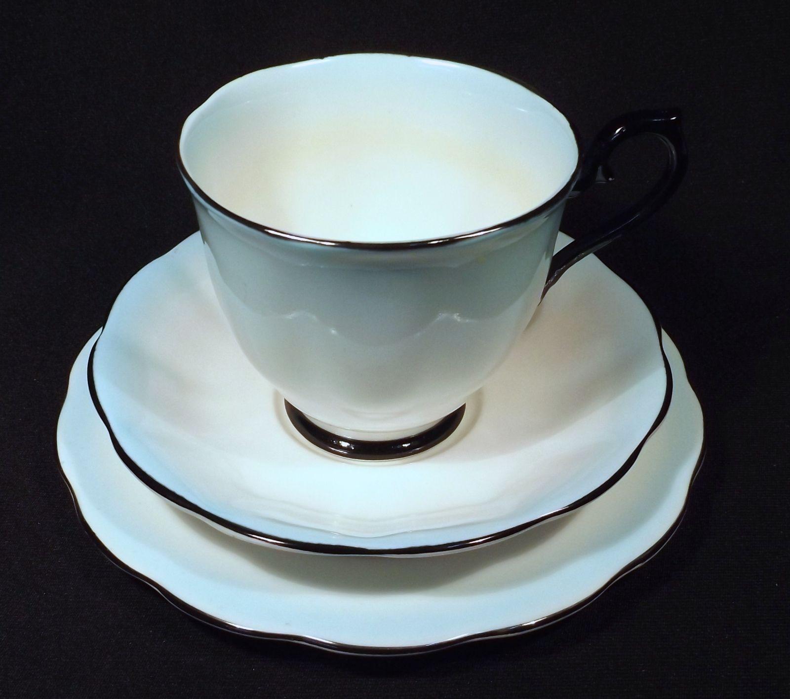 Royal albert bone china tea cup amp saucer winsome pattern ebay - 1950 S Royal Albert Bone China Trio Gradation Aqua To White With Contrasting Black Trim This