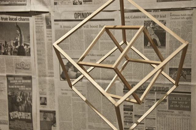Wooden mobile of nested cubes. by austin univ students