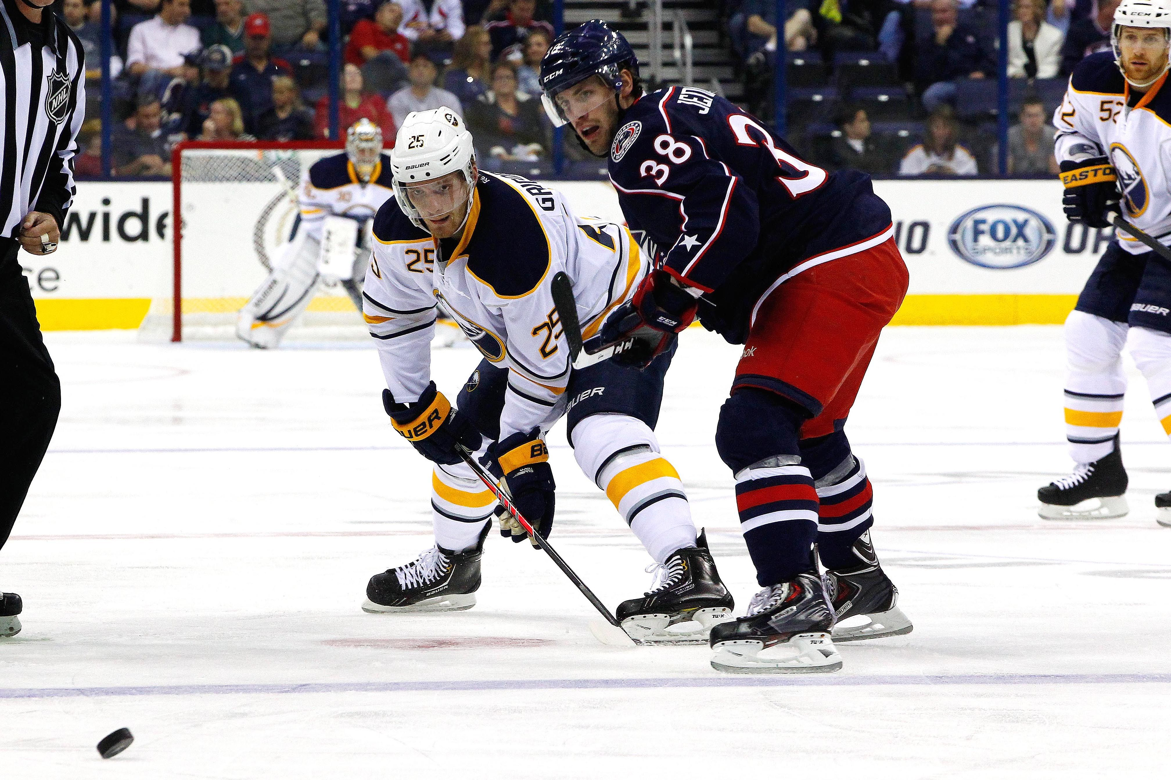 CrowdCam Hot Shot: Columbus Blue Jackets forward Boone Jenner and Buffalo Sabres center Mikhail Grigorenko faceoff during the first period at Nationwide Arena. Photo by Russell LaBounty
