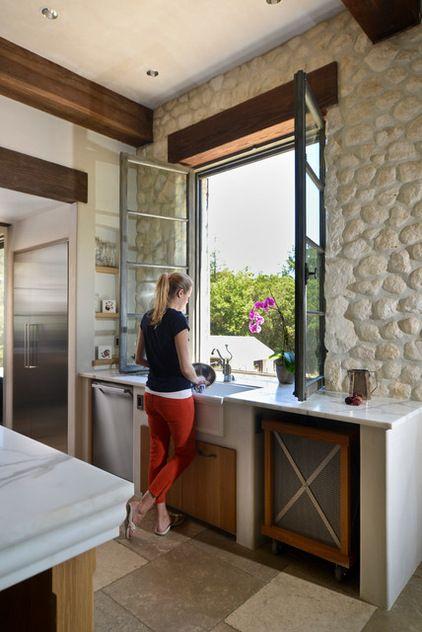 comfort world windows club mediterranean kitchen old world windows that open in surrounded by stone