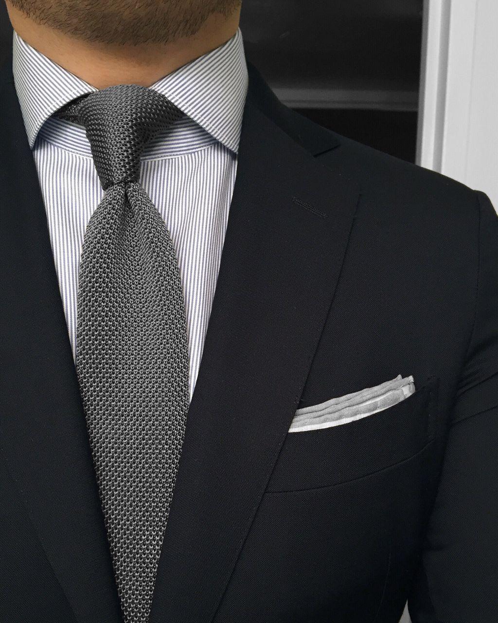 Black jacket, white shirt with light grey pinstripes ...