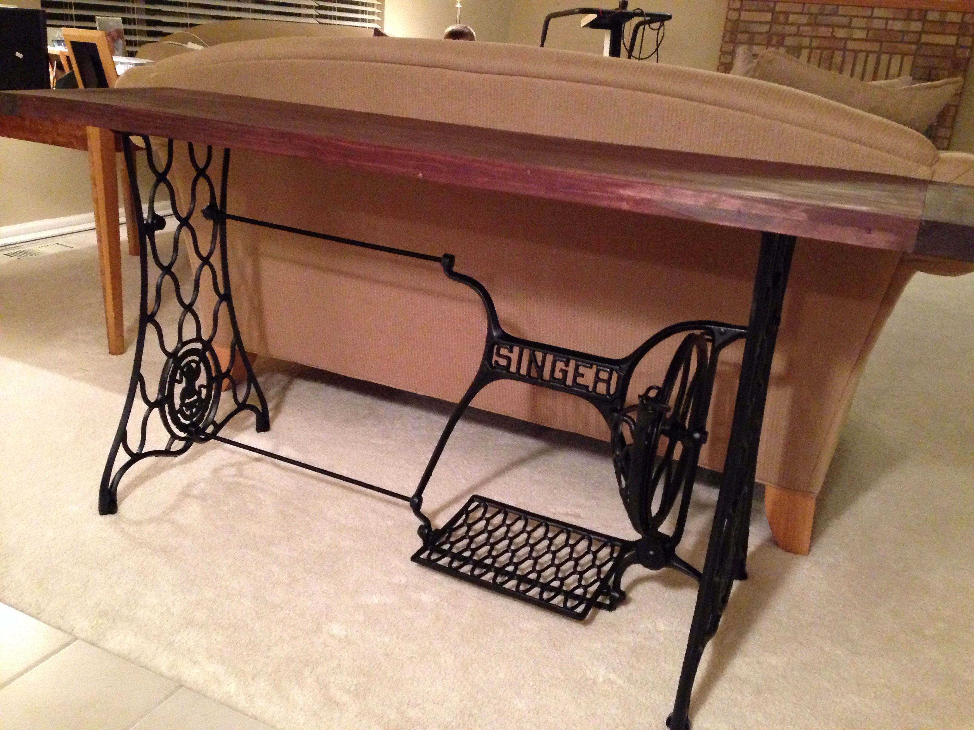 Sofa table from old Singer sewing machine table legs