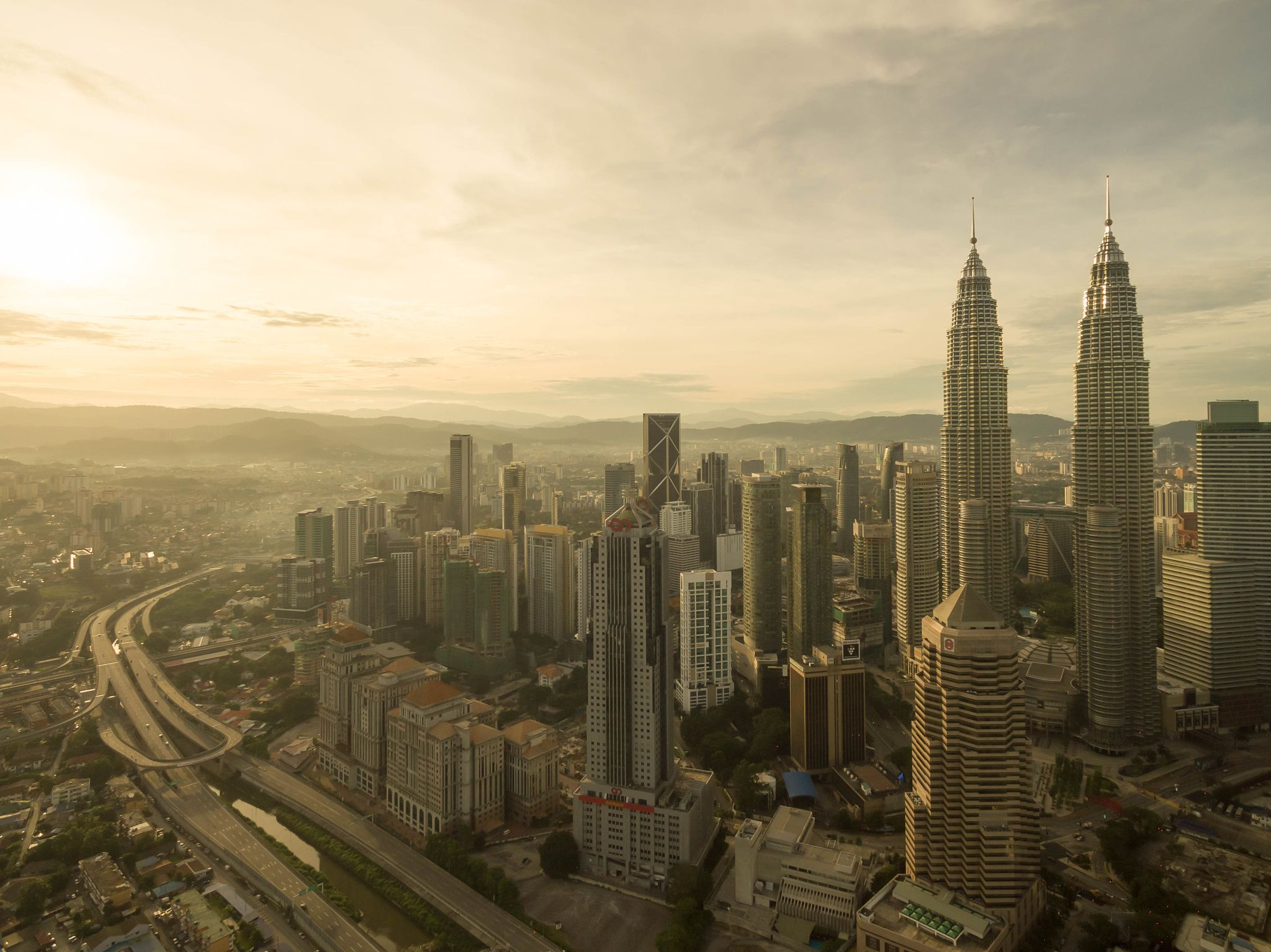 Golden city from the top - Kuala Lumpur, Malaysia - Jun 25, 2016: Aerial view of…