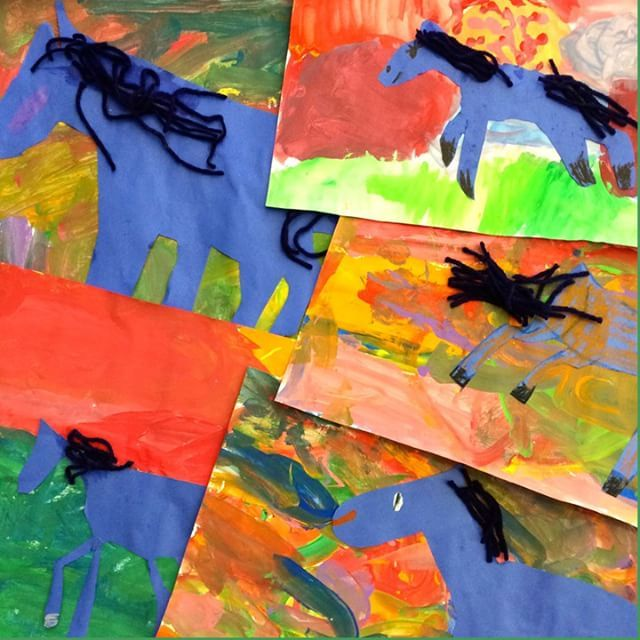Seven-year old Franz Marc Blue horse paintings. Don't you love these colors? We mixed our own tempera paint colors then painted our backgrounds with after reading Eric Carle's The Artist Who Painted a Blue Horse. After they dried, we drew a horse on, yo