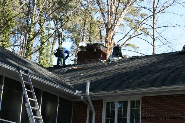 CRS crew members take care of the final touches at the end of this roof installation.