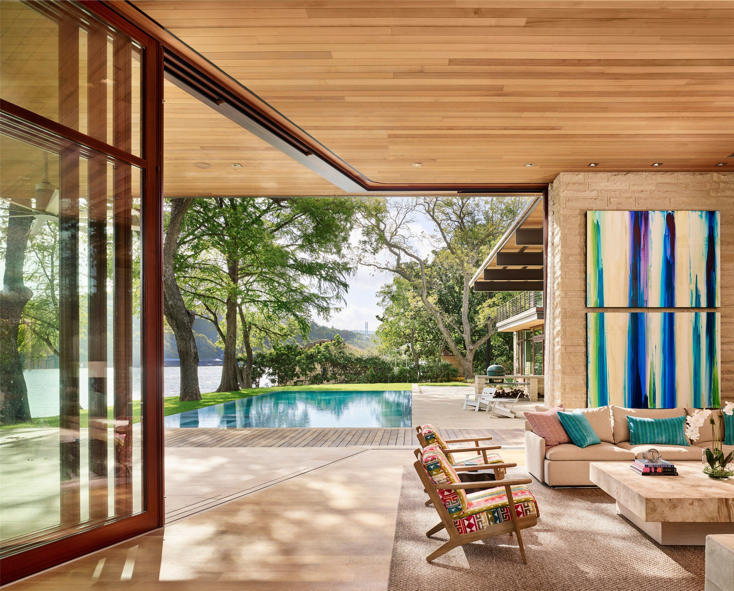 Living spaces open out to lake austin at residence by a parallel