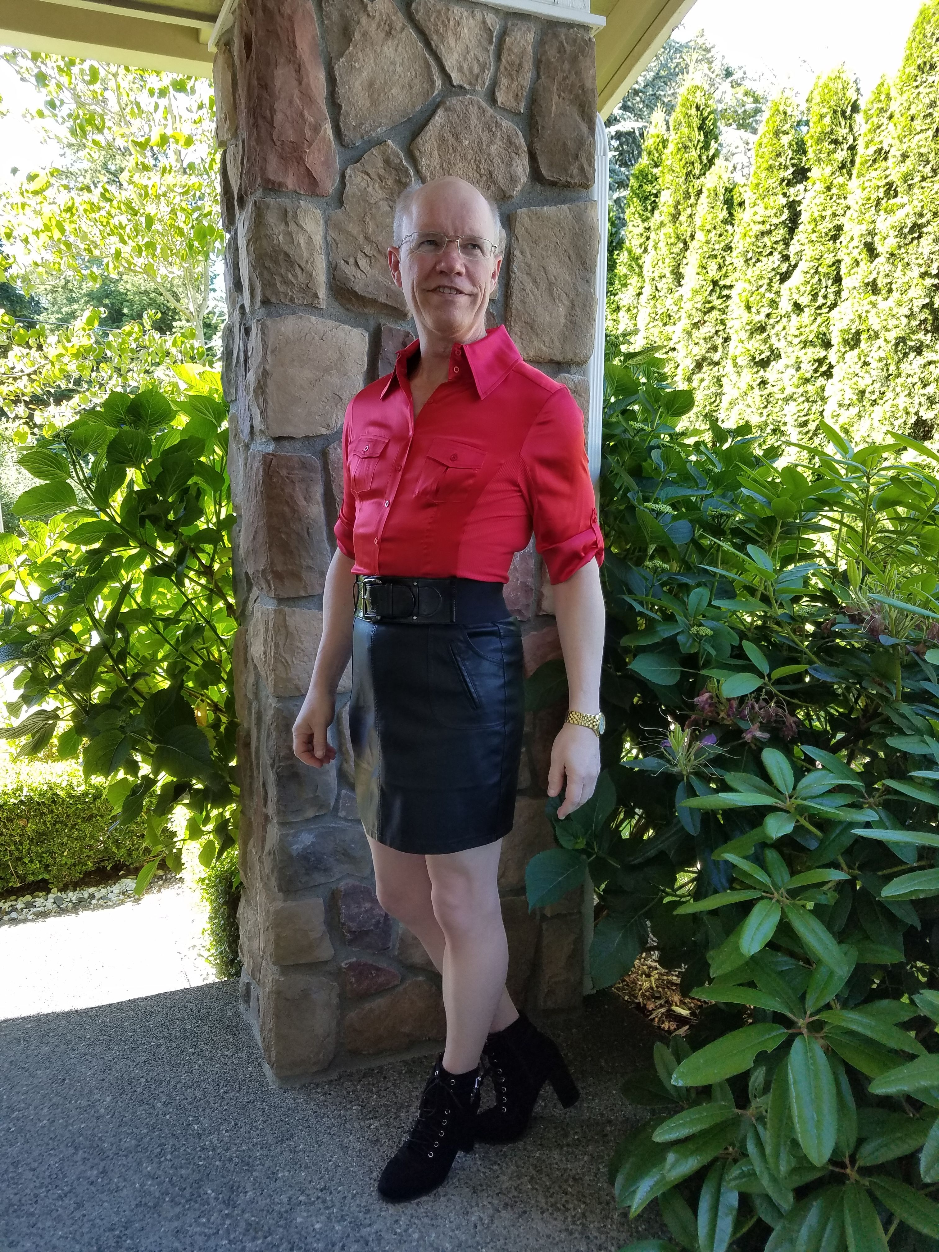 Black faux leather skirt, red silk shirt