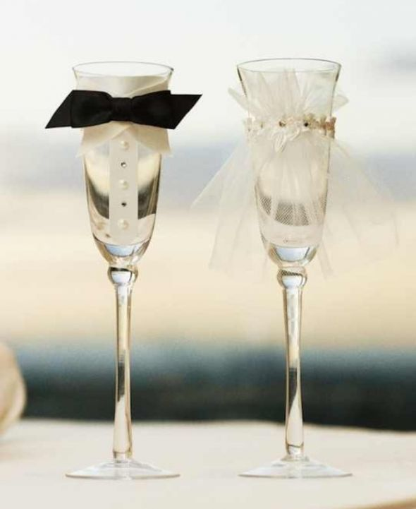 If i was having champagne at my wedding id have it in this wedding his and hers toasting glasses adorable bride and groom champagne flutes solutioingenieria Choice Image