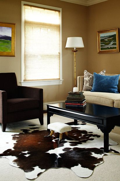 Jewel toned living room with peacock blue velvet pillow on ...