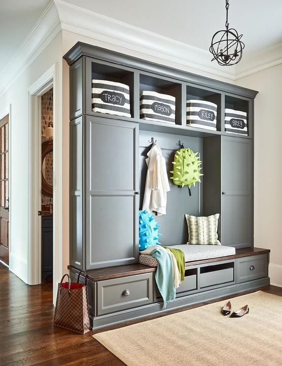 Great Transitional Mudroom Features Charcoal Gray Mudroom Cubbies Over A Wood  Bench Flanked By Locker Cabinets Illuminated By An Iron Sphere Pendant.