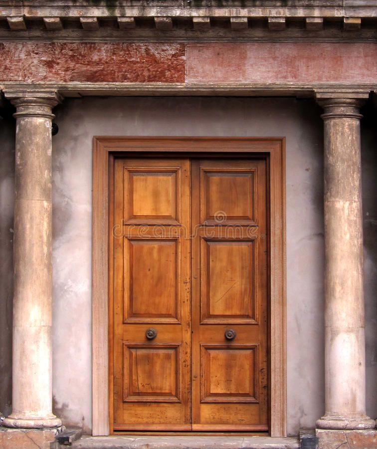 Old door. Vintage old fashioned door framed with roman style pillars ,